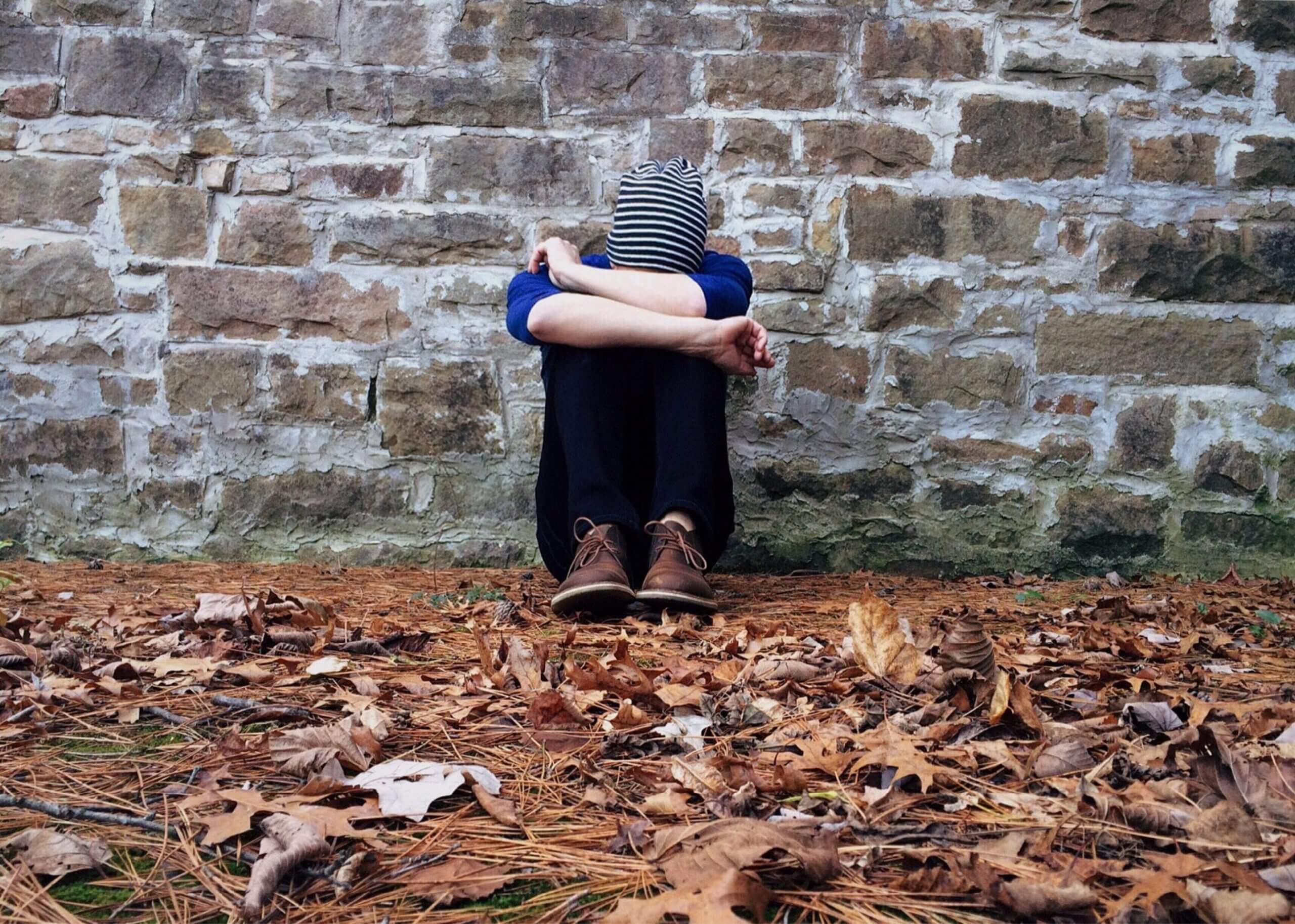 adult-alone-autumn-brick